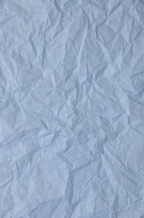 Blue crumpled paper as background