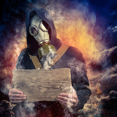 A man in a mask and with a board in the hands of