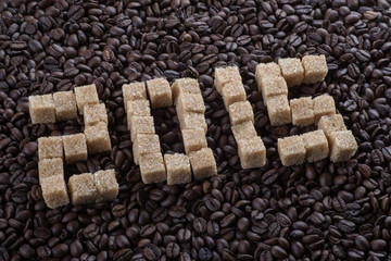 "Roasted coffee beans and sugar inscription ""2015"""
