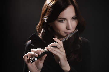 Woman with flute piccolo flutist