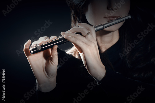 Flute piccolo with hands closeup - 75508966