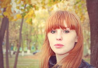 Pretty red hair girl looks at camera.Tonal correction.