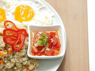 fried rice, fried eggs, fresh tomatoes & onions