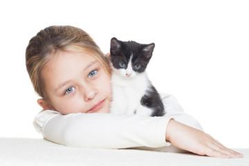 kid hugging a cute little kitten