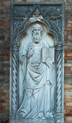 Stone statue of a saint, Torcello island, Venice, Italy