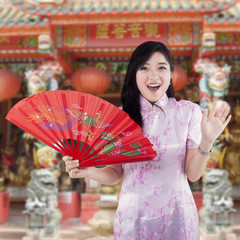 Chinese woman with traditional cheongsam dress