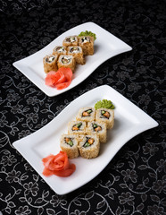 California rolls sushi decorated with pickled ginger