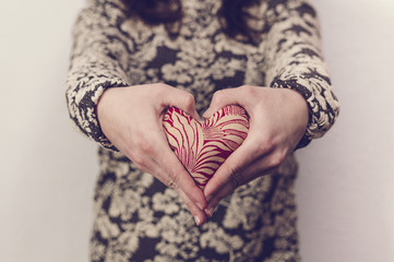 Woman holding a fabric heart. Valentine's day