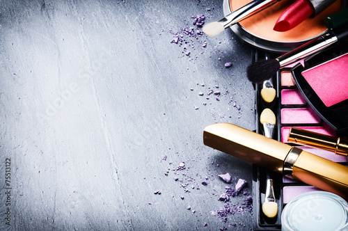 Various makeup products on dark background - 75513122