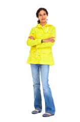 Young woman in yellow jacket and jeans