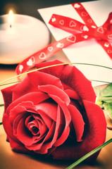 St Valentine's setting with red rose and love letter
