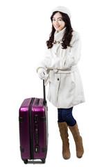 Girl in winter overcoat with suitcase