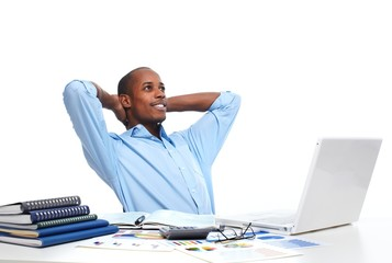 African-American businessman relaxing in office