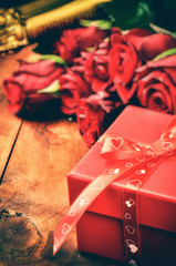 Valentine's setting with red roses and gift box