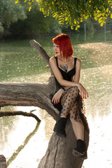 Pretty girl sit under the river