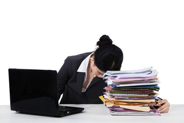 Overworked manager sleeping on document