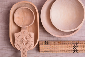 Wooden dishes on table, bowl, plate and spoon