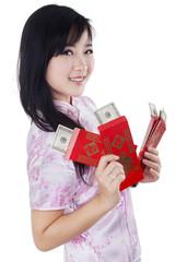 Teenage girl with money dollars cash in envelope