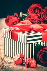 Valentine's setting with red roses and retro gift box