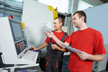 industrial workers at tool workshop