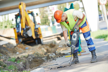 construction worker with perforator