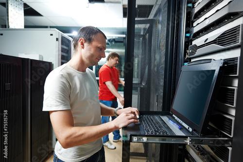 service engineer in server room - 75515758