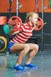 woman with weight bar in fitness gym
