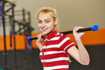woman with stick in fitness gym