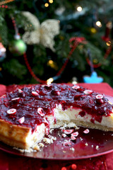 Cranberry Vanilla Cheesecake with Xmas Tree on Background