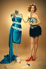 Pinup  near the manikin.Fashion Designer.Dressmaker