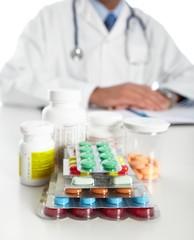 Doctor writing medical prescription.