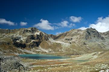 Beautiful turquoise alpine lake in the Swiss Alps