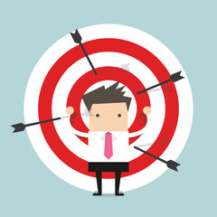 Businessman on archery targets