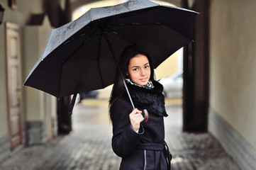 Pretty young woman with umbrella