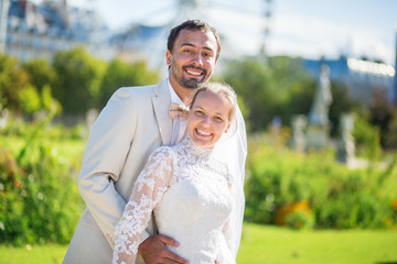 Just married couple in Tuileries garden of Paris