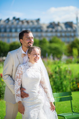 Just married couple in Tuileries garden of Paris