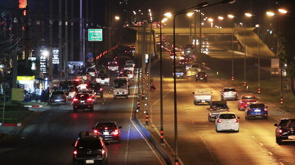Busy Traffic at night on highway.