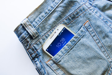 Mobile phone in jeans pocket.