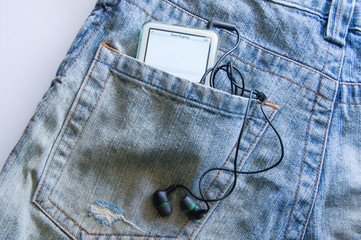 The music player in jeans pocket