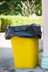 yellow recycle bin