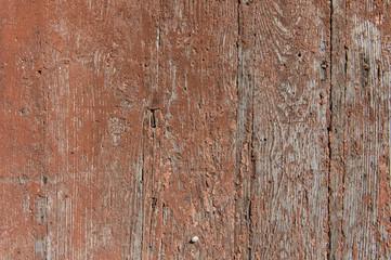 vecchie tavole di legno con pittura rossiccia screpolata