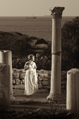bride with a bouquet of flowers is on the ancient city