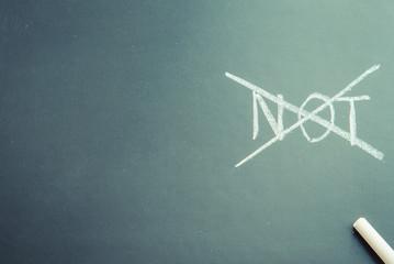 Write Not word on black board