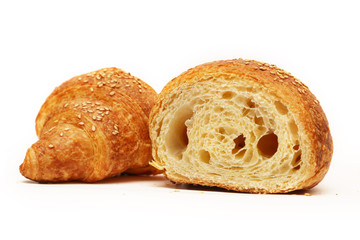 Fresh baked croissant on white with sesame seeds on top