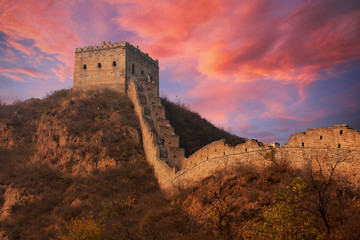 Great wall of China at sunset with dramatic clouds