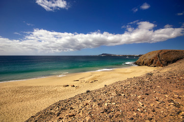 Lanzarote Papagayo turquoise beach and Ajaches in Canary Islands