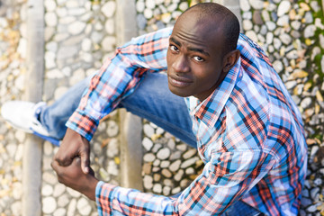 Black man wearing casual clothes in urban background