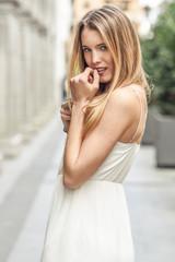 Beautiful blonde girl in urban background