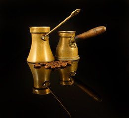 Old copper Cezves. Turkish Coffee Pot and Beans