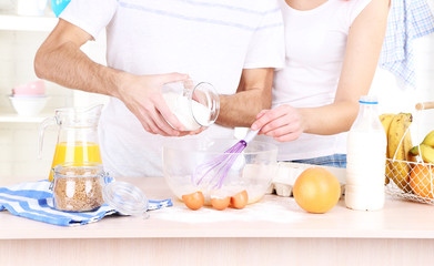 Couple preparing dough baking in kitchen